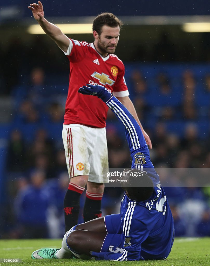 <a gi-track='captionPersonalityLinkClicked' href=/galleries/search?phrase=Juan+Mata&family=editorial&specificpeople=4784696 ng-click='$event.stopPropagation()'>Juan Mata</a> of Manchester United apologises as <a gi-track='captionPersonalityLinkClicked' href=/galleries/search?phrase=Kurt+Zouma&family=editorial&specificpeople=7905425 ng-click='$event.stopPropagation()'>Kurt Zouma</a> of Chelsea lies injured during the Barclays Premier League match between Chelsea and Manchester United at Stamford Bridge on February 7 2016 in London, England.