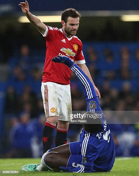 Juan Mata of Manchester United apologises as Kurt Zouma of Chelsea lies injured during the Barclays Premier League match between Chelsea and...
