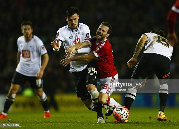 Juan Mata of Manchester United attempts to beat George Thorne and Bradley Johnson of Derby County during the Emirates FA Cup fourth round match...