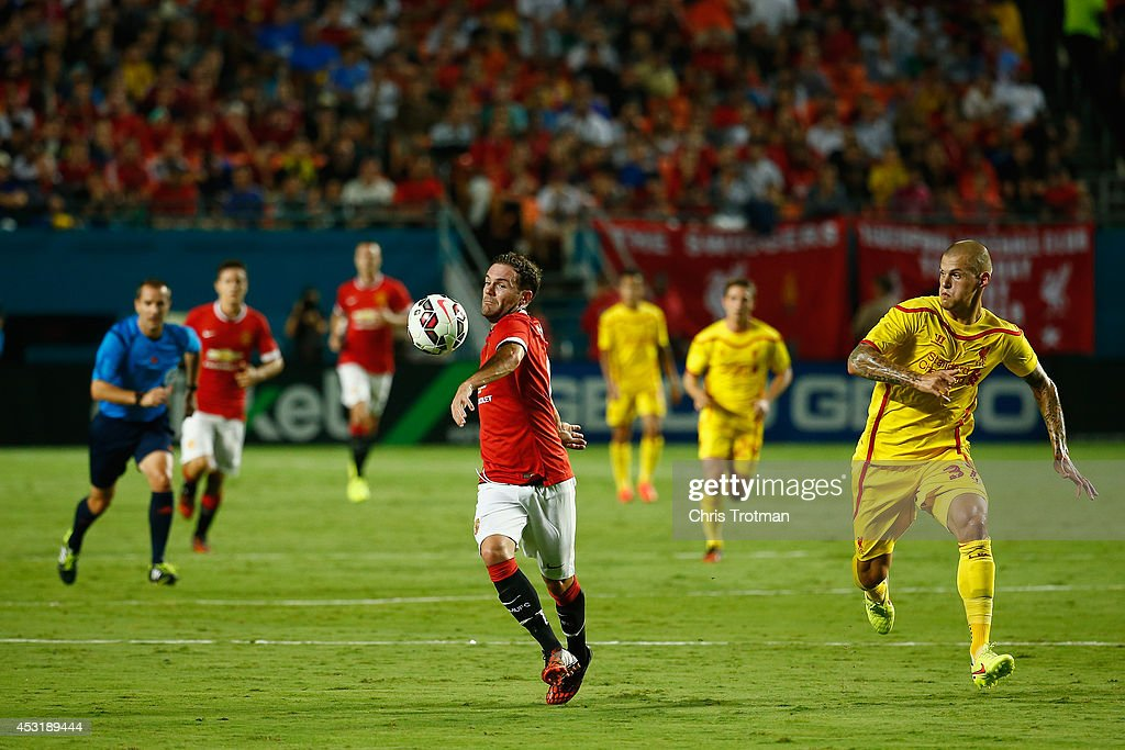Juan Mata #8 of Manchester United battles with (R) Martin Skrtel #37 of Liverpool in the Guinness International Champions Cup 2014 Final at Sun Life Stadium on August 4, 2014 in Miami Gardens, Florida.