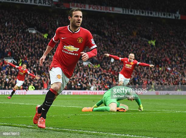 Juan Mata of Manchester United celebrates as he beats Joe Hart of Manchester City to score their third goal during the Barclays Premier League match...