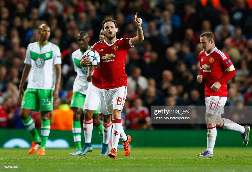 Juan Mata of Manchester United (8) celebrates as he scores their first and equalising goal from the penalty spot during the UEFA Champions League Group B match between Manchester United FC and VfL Wolfsburg at Old Trafford on September 30, 2015 in Manchester, United Kingdom.