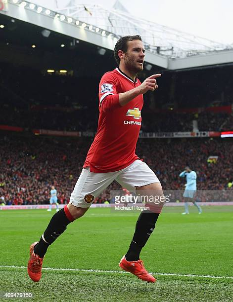 Juan Mata of Manchester United celebrates as scores their third goal during the Barclays Premier League match between Manchester United and...