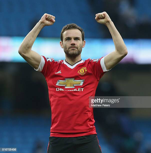 Juan Mata of Manchester United celebrates at final whistle during the Barclays Premier League match between Manchester City and Manchester United at...