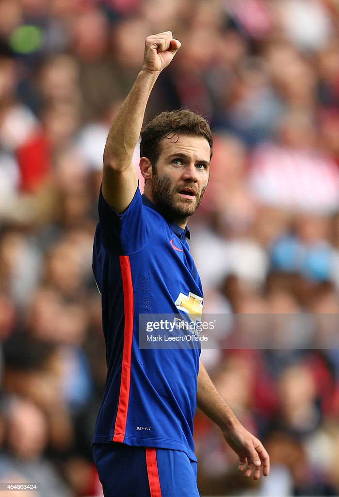 <a gi-track='captionPersonalityLinkClicked' href=/galleries/search?phrase=Juan+Mata&family=editorial&specificpeople=4784696 ng-click='$event.stopPropagation()'>Juan Mata</a> of Manchester United celebrates his goal during the Barclays Premier League match between Sunderland and Manchester United at Stadium of Light on August 24, 2014 in Sunderland, England.