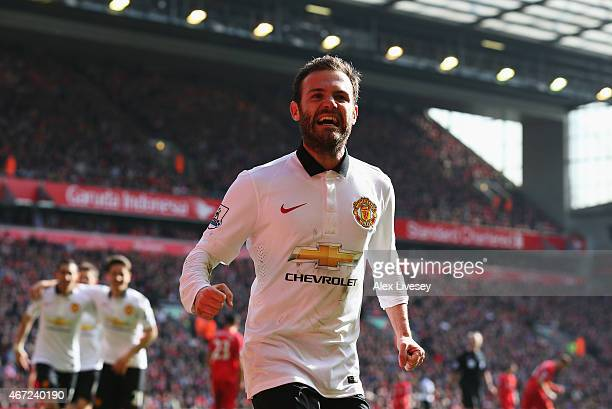Juan Mata of Manchester United celebrates scoring his second goal during the Barclays Premier League match between Liverpool and Manchester United at...