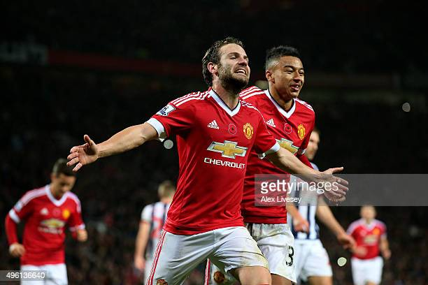 Juan Mata of Manchester United celebrates scoring his team's second goal during the Barclays Premier League match between Manchester United and West...