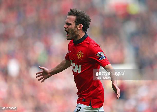 Juan Mata of Manchester United celebrates scoring his team's third goal during the Barclays Premier League match between Manchester United and Aston...