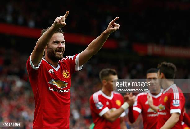 Juan Mata of Manchester United celebrates scoring his team's third goal during the Barclays Premier League match between Manchester United and...