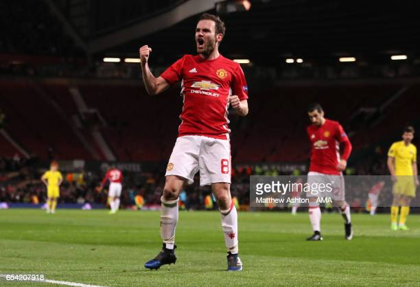 Juan Mata of Manchester United celebrates scoring the first goal which made the score 10 during the UEFA Europa League Round of 16 second leg match...