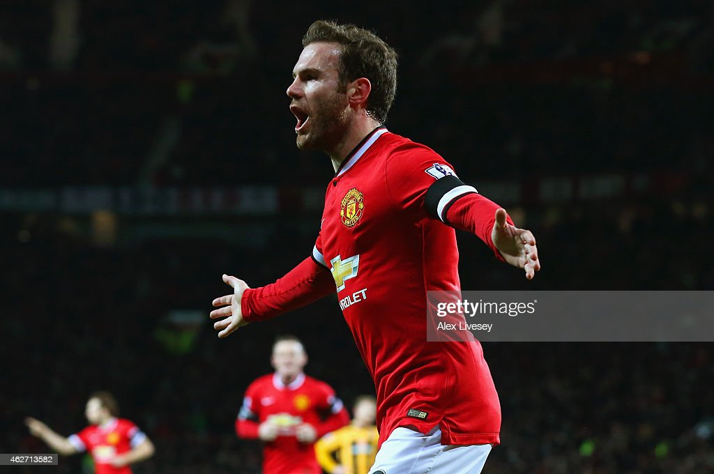 Juan Mata of Manchester United celebrates scoring the opening goal during the FA Cup Fourth round replay match between Manchester United and Cambridge United at Old Trafford on February 3, 2015 in Manchester, England.