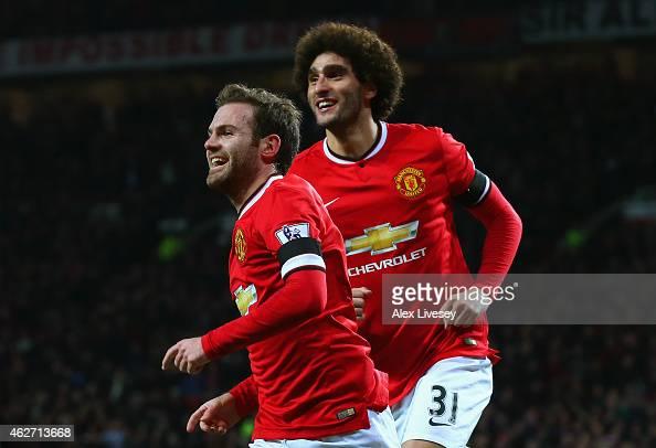 Juan Mata of Manchester United celebrates scoring the opening goal with Marouane Fellaini of Manchester United during the FA Cup Fourth round replay...