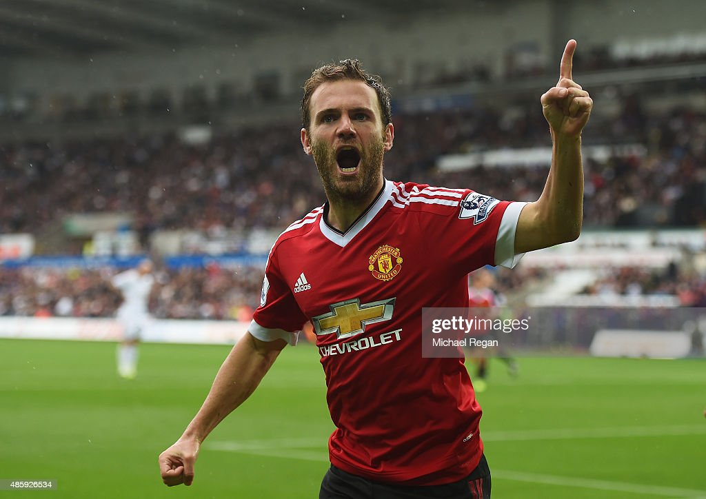 Juan Mata of Manchester United celebrates scoring the opening goal during the Barclays Premier League match between Swansea City and Manchester United at Liberty Stadium on August 30, 2015 in Swansea, Wales.