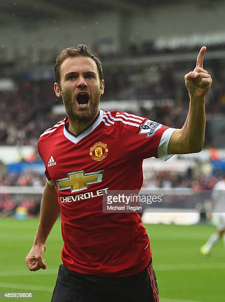 Juan Mata of Manchester United celebrates scoring the opening goal during the Barclays Premier League match between Swansea City and Manchester...