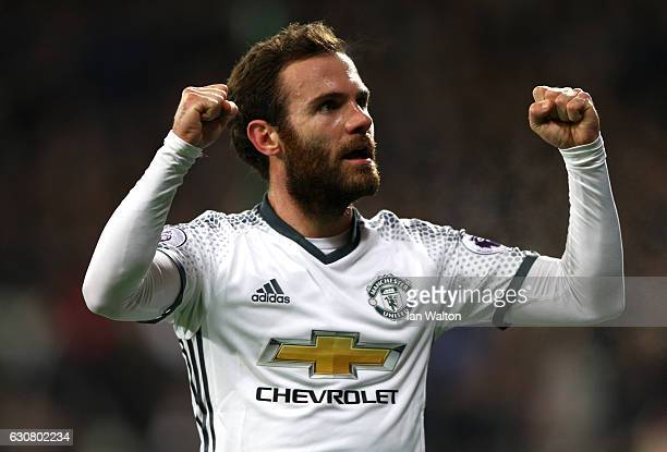 Juan Mata of Manchester United celebrates scoring the opening goal during the Premier League match between West Ham United and Manchester United at...
