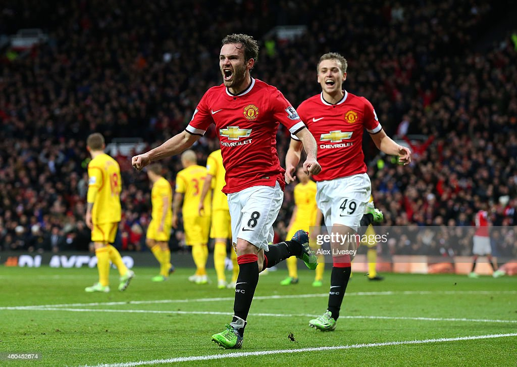 Juan Mata of Manchester United celebrates scoring the second goal during the Barclays Premier League match between Manchester United and Liverpool at Old Trafford on December 14, 2014 in Manchester, England.