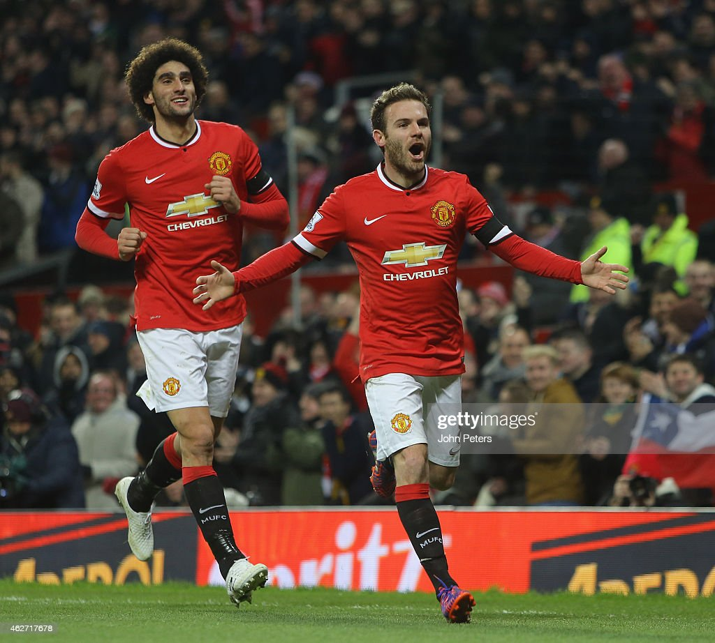 Juan Mata of Manchester United celebrates scoring their first goal during the FA Cup Fourth Round replay between Manchester United and Cambridge United at Old Trafford on February 3, 2015 in Manchester, England.