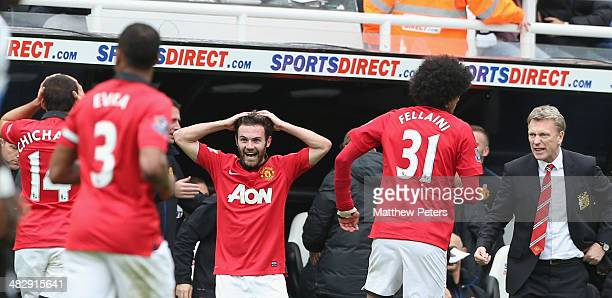 Juan Mata of Manchester United celebrates scoring their first goal during the Barclays Premier League match between Newcastle United and Manchester...