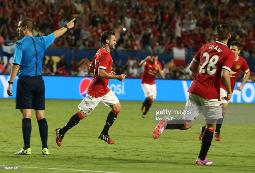 Juan Mata of Manchester United celebrates scoring their second goal during the pre-season friendly match between Manchester United and Liverpool at Sun Life Stadium on August 4, 2014 in Miami Gardens, Florida.