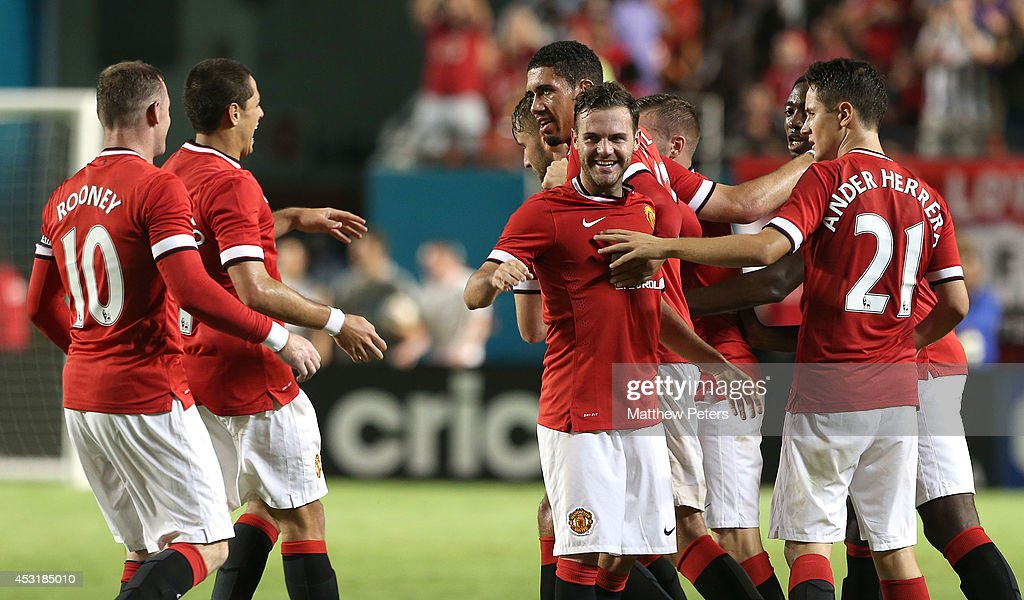 Juan Mata of Manchester United (C) celebrates scoring their second goal during the pre-season friendly match between Manchester United and Liverpool at Sun Life Stadium on August 4, 2014 in Miami Gardens, Florida.