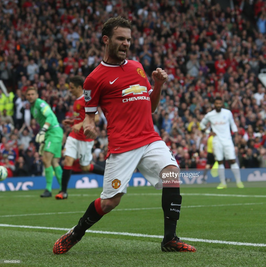 Juan Mata of Manchester United celebrates scoring their third goal during the Barclays Premier League match between Manchester United and Queens Park Rangers at Old Trafford on September 14, 2014 in Manchester, England.