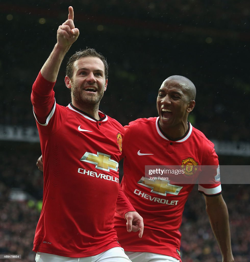 Juan Mata of Manchester United celebrates scoring their third goal during the Barclays Premier League match between Manchester United and Manchester City at Old Trafford on April 12, 2015 in Manchester, England.