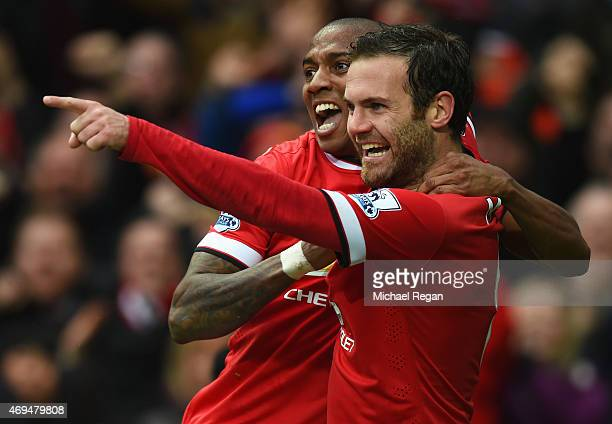 Juan Mata of Manchester United celebrates with Ashley Young as scores their third goal during the Barclays Premier League match between Manchester...