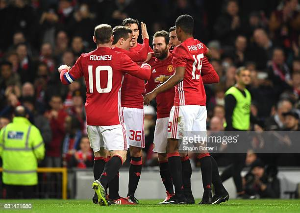 Juan Mata of Manchester United celebrates with team mates after scoring his sides first goal during the EFL Cup SemiFinal First Leg match between...