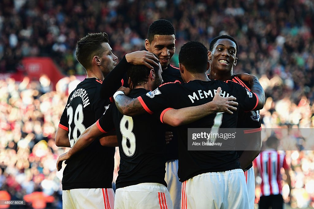 Juan Mata of Manchester United (8) celebrates with team mates as he scores their third goal during the Barclays Premier League match between Southampton and Manchester United at St Mary's Stadium on September 20, 2015 in Southampton, United Kingdom.