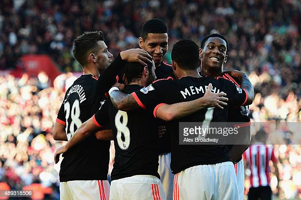 Juan Mata of Manchester United celebrates with team mates as he scores their third goal during the Barclays Premier League match between Southampton...