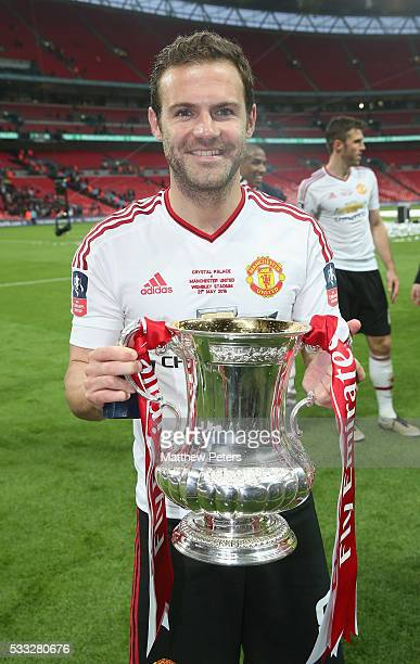 Juan Mata of Manchester United celebrates with the FA Cup trophy after The Emirates FA Cup final match between Manchester United and Crystal Palace...