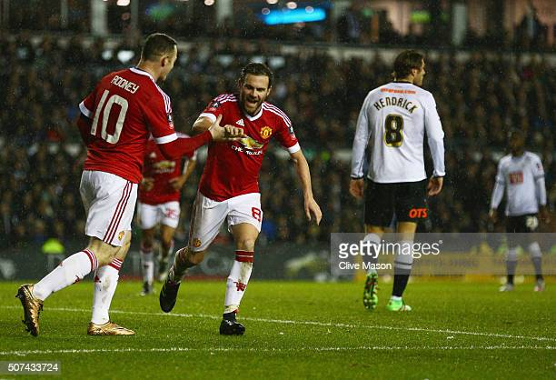 Juan Mata of Manchester United celebrates with Wayne Rooney as he scores their third goal during the Emirates FA Cup fourth round match between Derby...