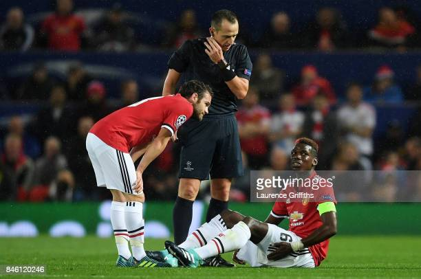Juan Mata of Manchester United checks if Paul Pogba of Manchestr United is okay after he goes down injured during the UEFA Champions League Group A...