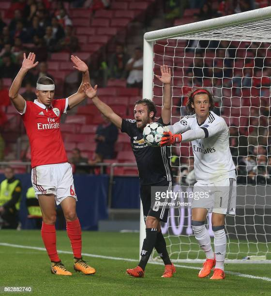 Juan Mata of Manchester United claims the goal after Mile Svilar of Benfica carries the ball into the net to allow Marcus Rashford of Manchester...