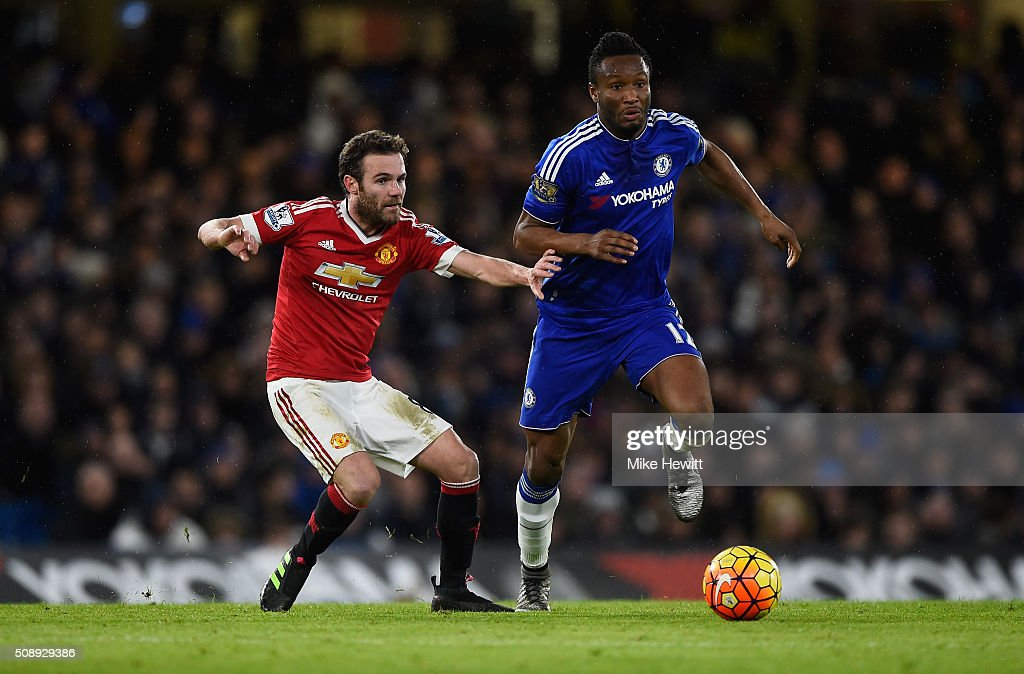 Juan Mata of Manchester United closes down John Mikel Obi of Chelsea during the Barclays Premier League match between Chelsea and Manchester United at Stamford Bridge on February 7, 2016 in London, England.