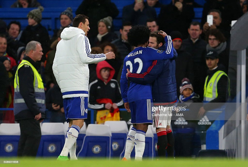 Juan Mata of Manchester United gets a hug from former team mate Willian of Chelsea after the Barclays Premier League match between Chelsea and Manchester United at Stamford Bridge on February 7, 2016 in London, England.