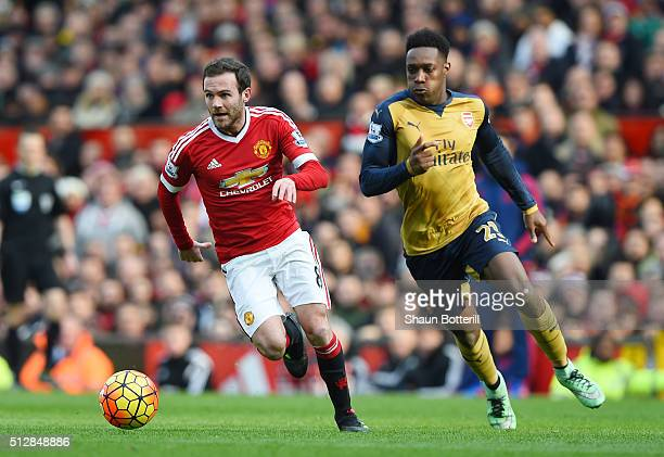 Juan Mata of Manchester United goes past Danny Welbeck of Arsenal during the Barclays Premier League match between Manchester United and Arsenal at...