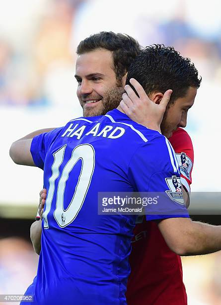 Juan Mata of Manchester United hugs Eden Hazard of Chelsea during the Barclays Premier League match between Chelsea and Manchester United at Stamford...
