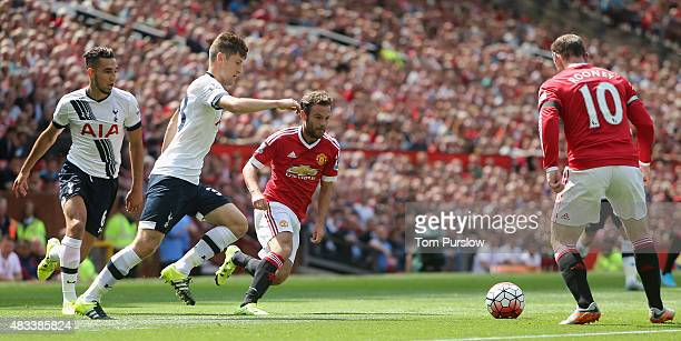 Juan Mata of Manchester United in action with Ben Davies of Tottenham Hotspur during the Barclays Premier League match between Manchester United and...