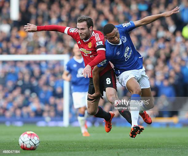 Juan Mata of Manchester United in action with Brendan Galloway of Everton during the Barclays Premier League match between Everton and Manchester...