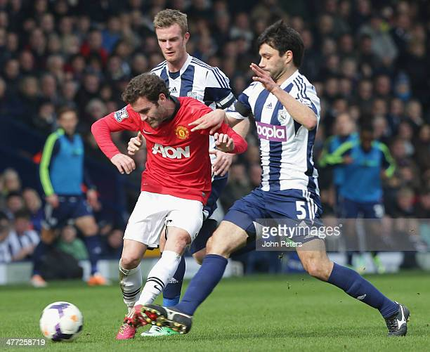 Juan Mata of Manchester United in action with Chris Brunt and Claudio Yacob of West Bromwich Albion during the Barclays Premier League match between...