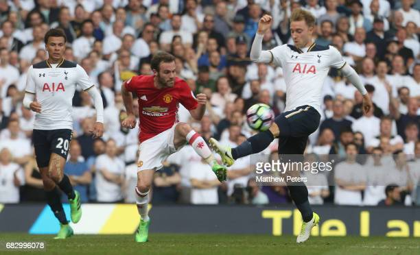 Juan Mata of Manchester United in action with Christian Eriksen of Tottenham Hotspur during the Premier League match between Mancheser United and...