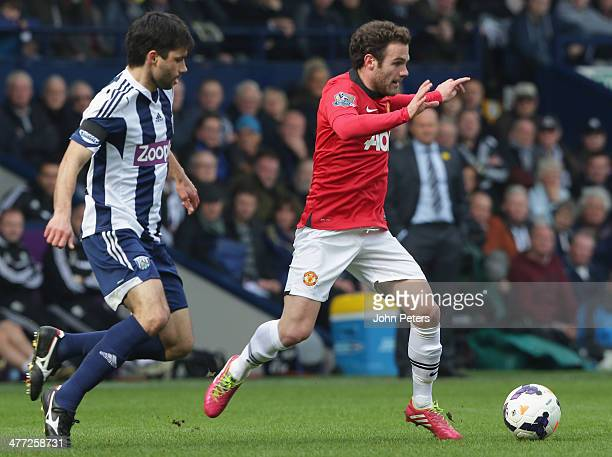 Juan Mata of Manchester United in action with Claudio Yacob of West Bromwich Albion during the Barclays Premier League match between West Bromwich...
