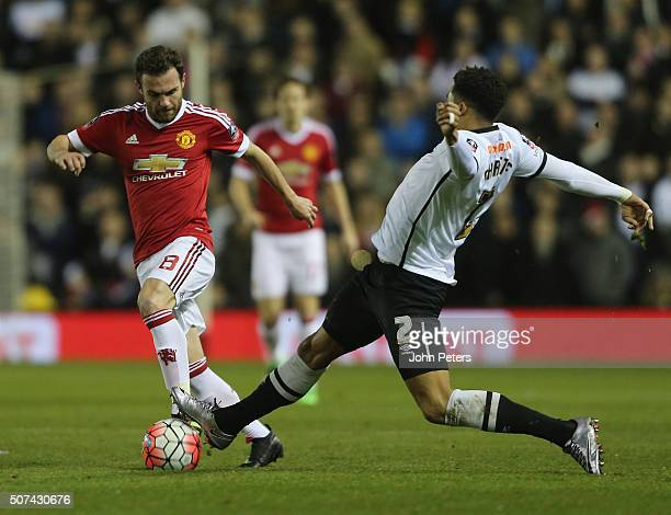 Juan Mata of Manchester United in action with Cyrus Christie of Derby County during the Emirates FA Cup Fourth Round match between Derby County and...