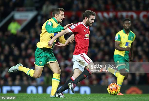 Juan Mata of Manchester United in action with Gary O'Neil of Norwich City during the Barclays Premier League match between Manchester United and...