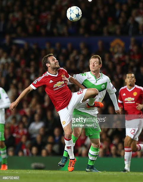 Juan Mata of Manchester United in action with Maximilian Arnold of VfL Wolfsburg during the UEFA Champions League Group C match between Manchester...