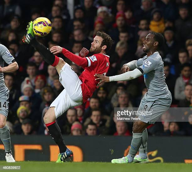 Juan Mata of Manchester United in action with Vurnon Anita of Newcastle United during the Barclays Premier League match between Manchester United and...