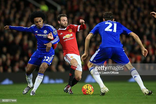 Juan Mata of Manchester United in action with Willian and Nemanja Matic of Chelsea during the Barclays Premier League match between Manchester United...