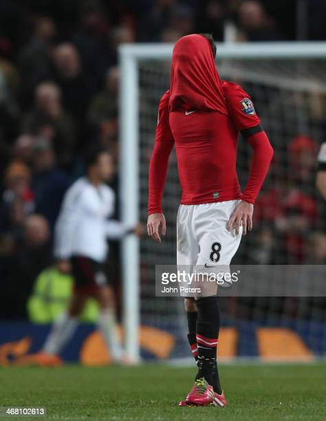 Juan Mata of Manchester United ireacts to conceding a goal to Darren Bent of Fulham during the Barclays Premier League match between Manchester...