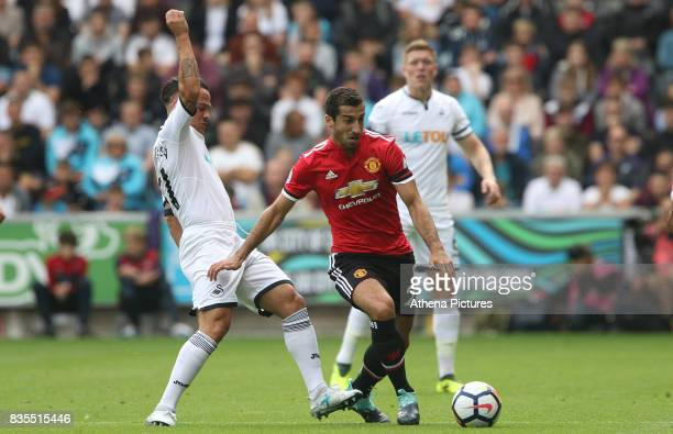 Juan Mata of Manchester United is challenged by Roque Mesa of Swansea City during the Premier League match between Swansea City and Manchester United...
